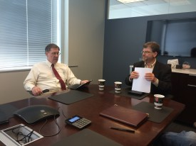 Adjunct professors Mac McKinney (left) and Steve Epner discuss plans at an executive meeting for Gateway Venture Mentoring Service on April 24.
