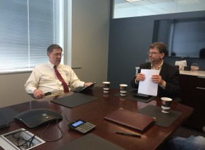 Adjunct professors Mac McKinney (left) and Steve Epner discuss plans at an executive meeting for Gateway Venture Mentoring Service on April 24.