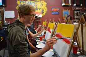 Webster student Brennan Almus paints a landscape. / photo by Julia Peschel