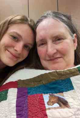 Hayley (left) and Kelsey Rightnowar frequently visit their mother Angie (right) and are very involved in her recovery process. / photo contributed by the Rightnowar family
