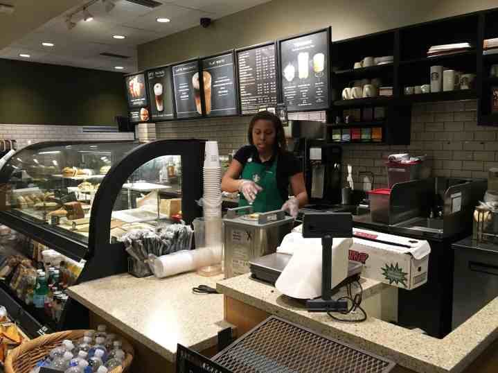 Alyssa Potter, a public relations major at Webster University, prepares pastries for a display at Starbucks in Rock Hill. Nikki Waller | The Journal