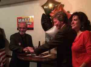 "Sebastian ""Bud"" Bellomo and Matt Armstrong celebrating their win March 5. JESSICA KARINS | The Journal"