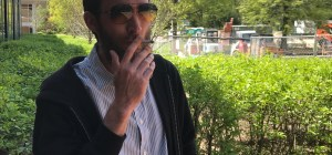 Math professor Larry Granda smokes a hand-rolled cigarette / Photo by Andrew McMunn
