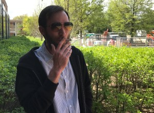 Math professor Larry Granda smokes a hand-rolled cigarette / Photo by Andrew McMunn