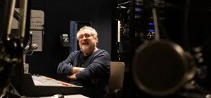 Jim Singer sits in the studio