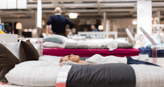 woman-trying-mattress-in-store