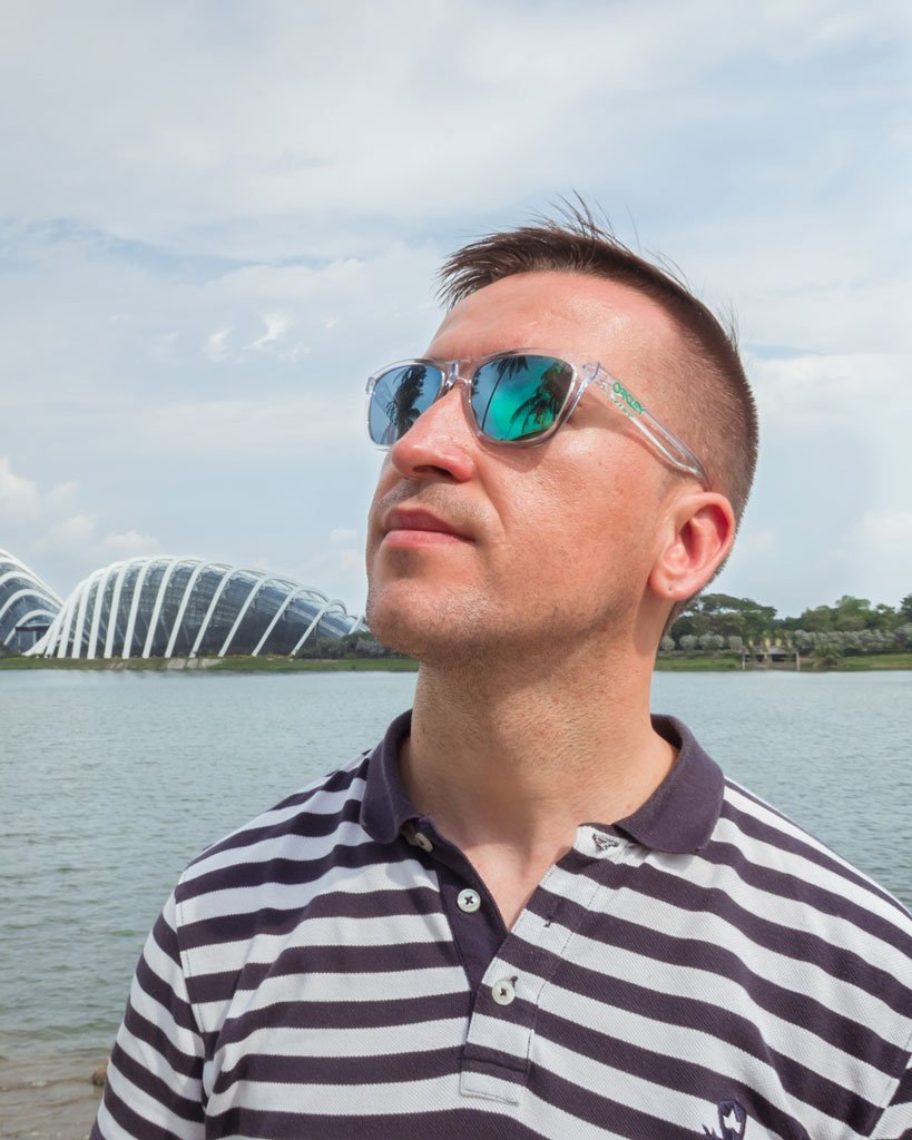 Marius from We Collect Postcards, with glasses, in front of Gardens by the Bay, Singapore