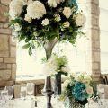 Elegant wedding reception centerpieces ivory hydrangeas teal accents