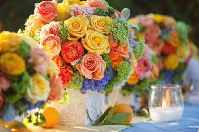 bright summer wedding flower centerpiece citrus hues with roses