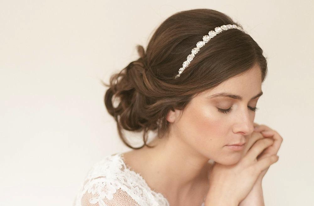 simple wedding updo with rhinestone