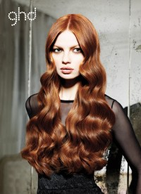 Long loose waves wedding hairstyle parted down the middle