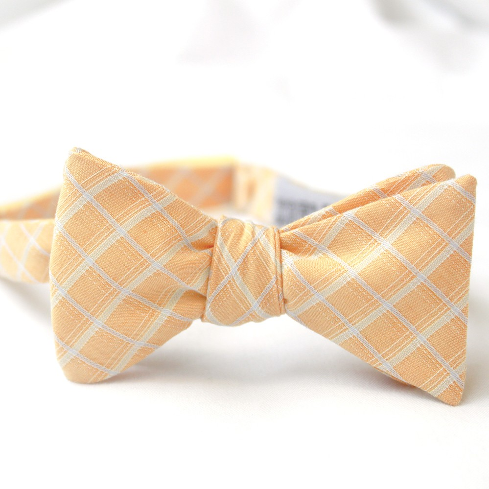 Muted peach and white patterned groom's bow tie for