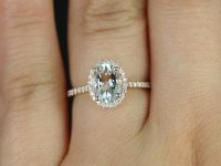 Rose Gold and White Sapphire Oval Cut Engagement Ring