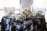 elegant wedding tablescape black lace overlay silver vases ...