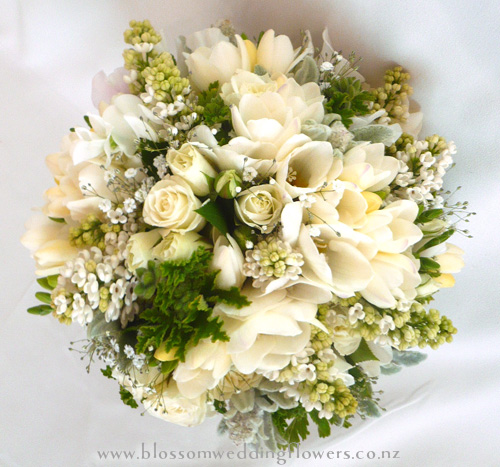 Buttonholes, White Freesia, With Lilac Florets And Fern Detail. Bound