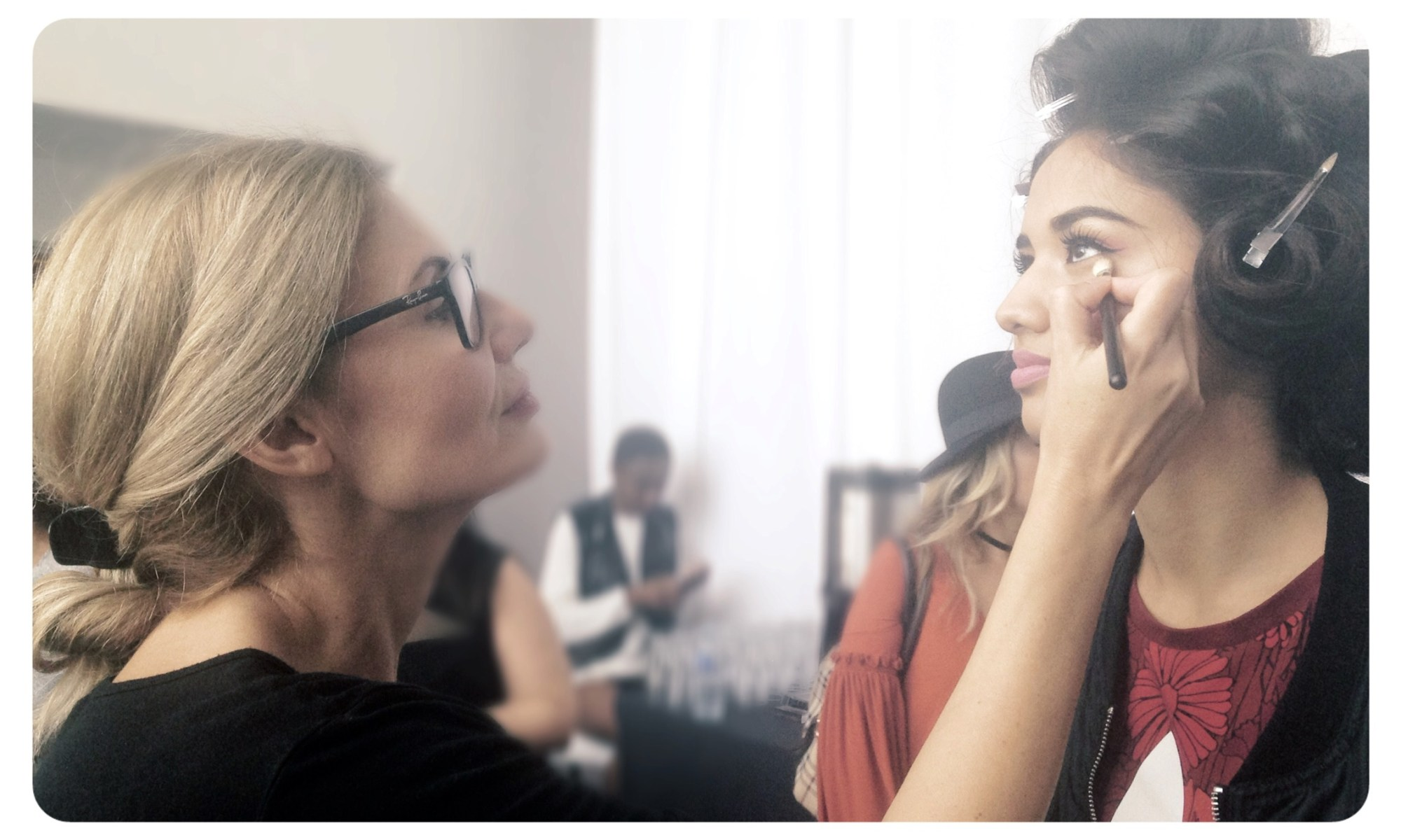 Irene Kyranis, a Bridal make up artist in Greece is applying make up to a beautiful bride
