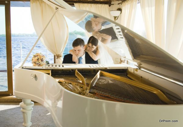 Bride and groom at the grand piano