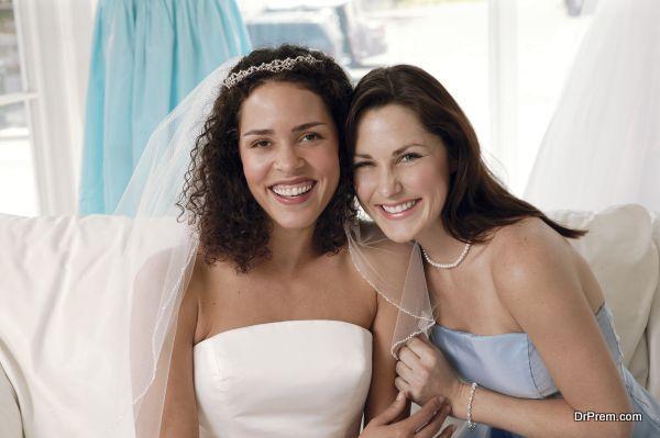 Bride and bridesmaid in bridal shop