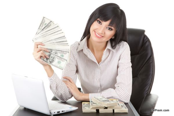 Elegant business woman with pile of money