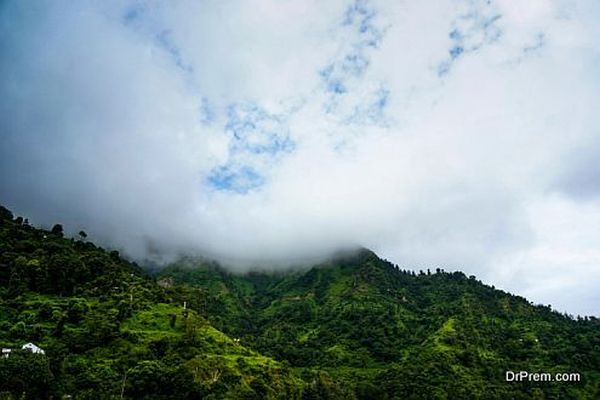 clouds rolling over the green hills of shimla