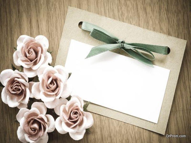 Vintage greeting card and rose flower.