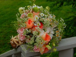 Garden style white ;ink and peach bridal bouquet