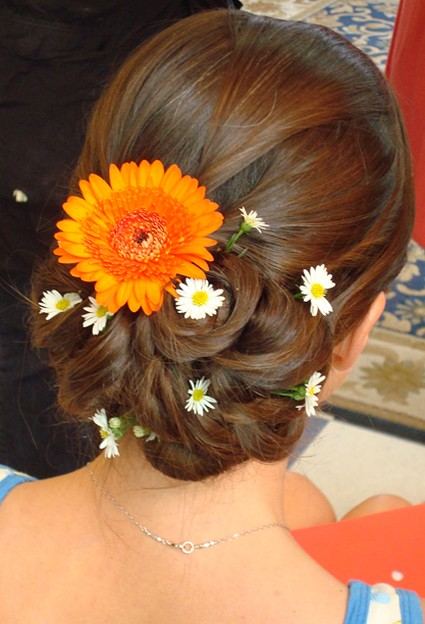 beach wedding hairstyle updo with fresh flowers in orange and daisyjpg 1 comment