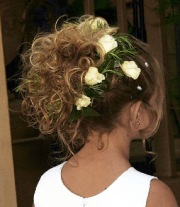 curly flower girl hairstyle updo