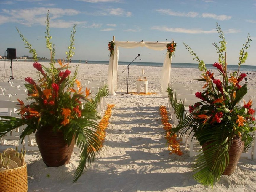 Wedding flowers on sand, canopy, vases - for Sarasota beach wedding ceremony