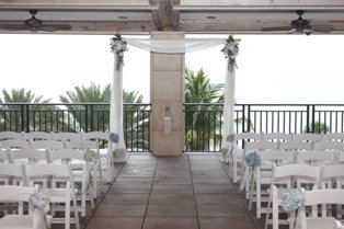 Ritz Beach Club Sarasota with Wedding Flowers along Aisle