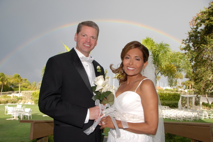Longboat Key Bride and Groom with Wedding Flowers and Rainbow in Background