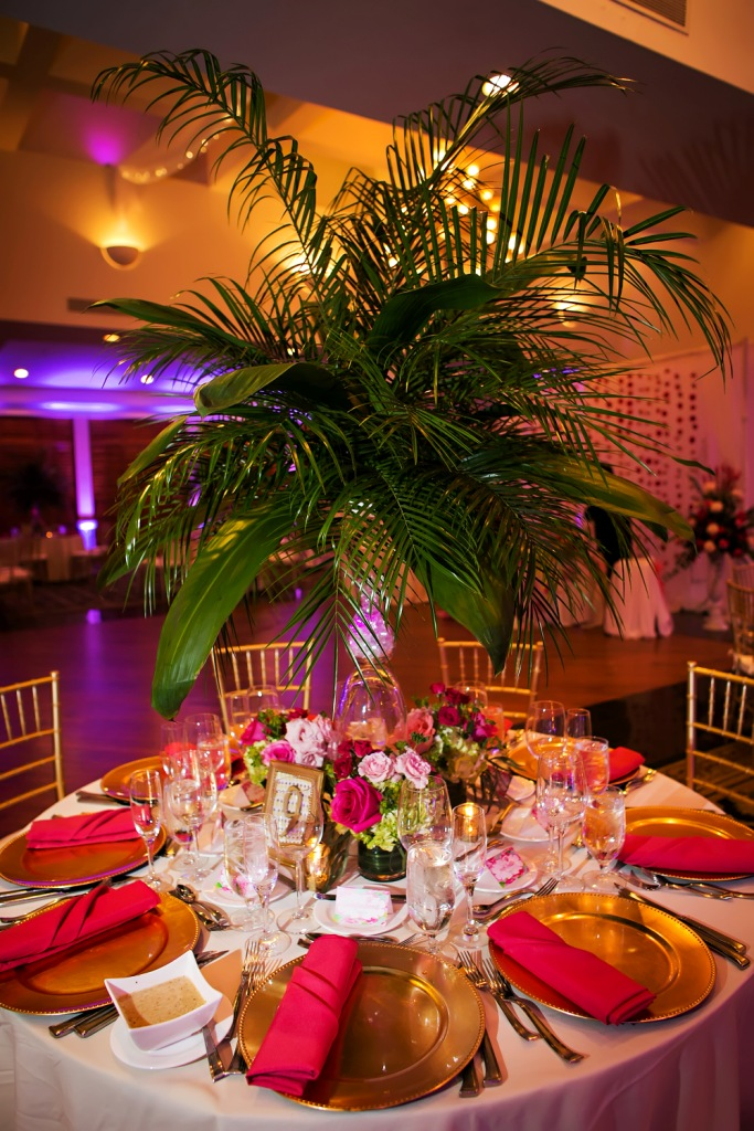 Palm arrangement with smaller rose arrangements at bottom