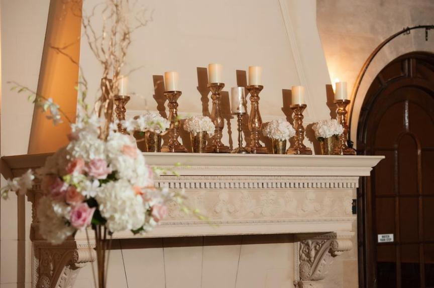 Mantle with white flowers and candles