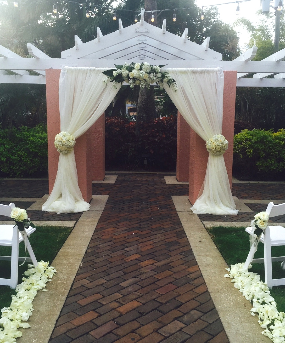 Wedding Ceremony Site with White Draping and White Flowers