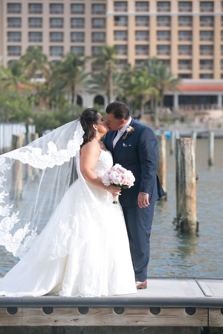 Bride with Bouquet on Dock at Hyatt