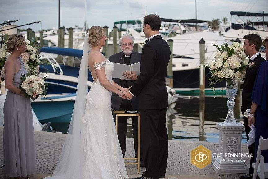 Ceremony Site with Bride, Groom, Officiant, and Flowers