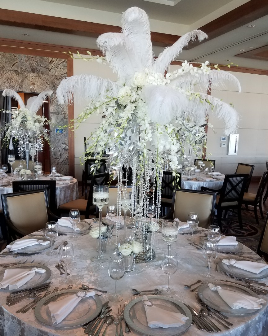 Great Gatsby Look Table Centerpiece with Orchids Ostrich Plumes and Hanging Pearls