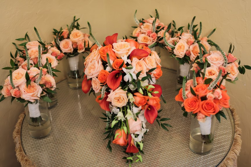 Incredible Coral Bridal Bouquet with Hand-Tied Bridesmaids Bouquets