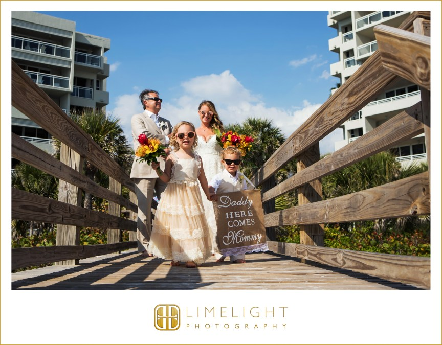 Bride and Groom with Children plus bouquets and signs