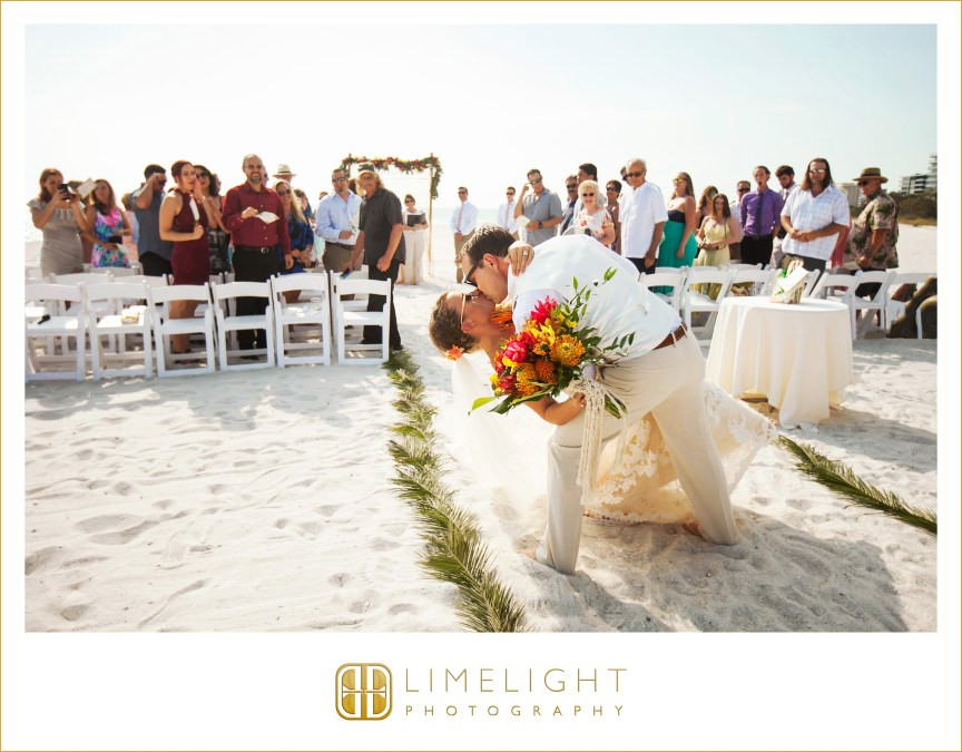 Groom Kissing Bride-Tropical Floral Bridal Bouquet