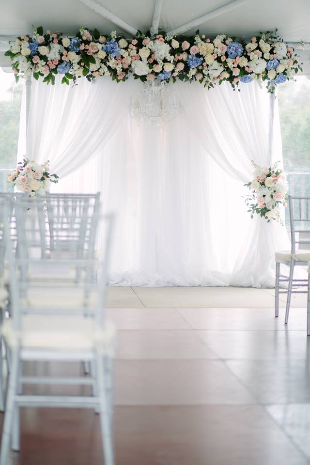 Arch with Floral swags and across the top