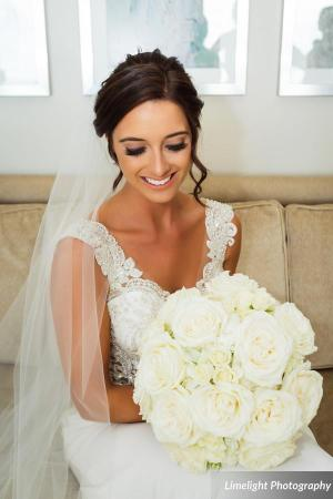 Beautiful bride with All-white Bouquet