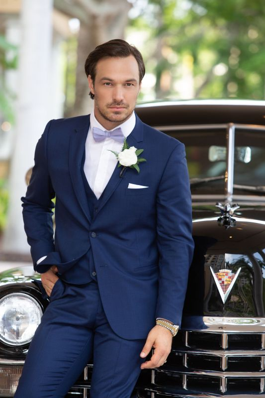 Groom wiht Boutonniere and Antique Car