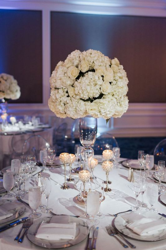 Close Up of Elevated All White Hydrangea and Rose Centerpiece
