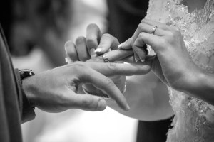 Man and woman exchanging rings