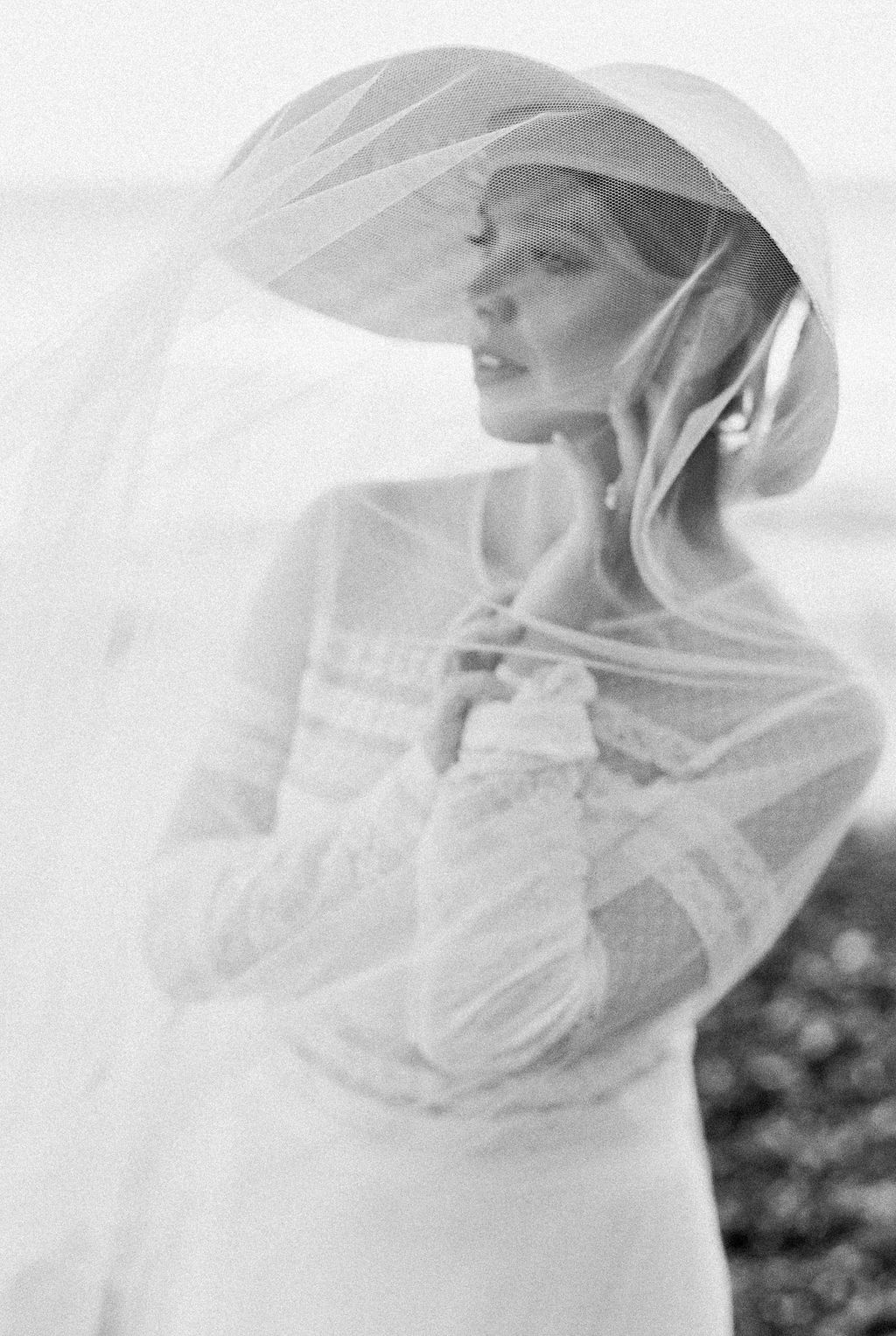 Black and white portait of a windswept bride on a coastal elopement