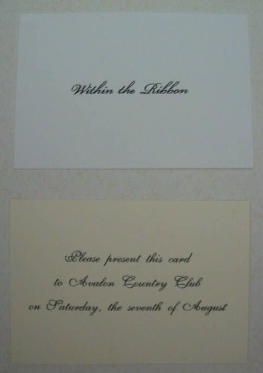 wedding invitation enclosure within the ribbon