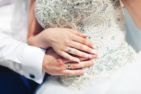 bride & groom's hands with wedding rings