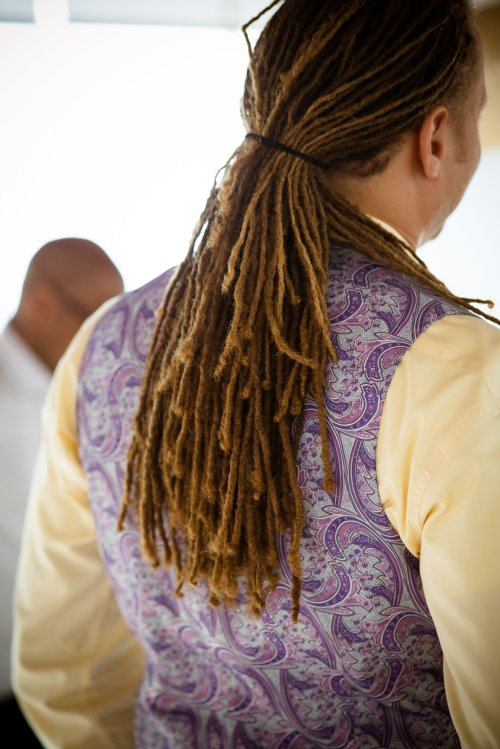 groom in purple and yellow