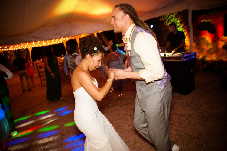 bride and groom dancing at beach reception